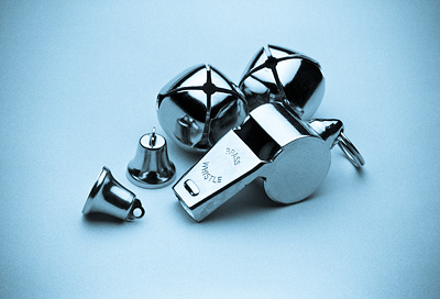Photograph of small bells and a whistle.